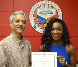 Temitope Gaudet with Nabendu Pal presenting her certificate