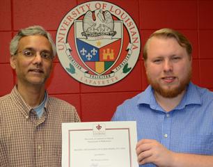 Thomas Credeur with Nabendu Pal presenting his certificate