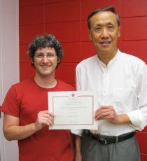 Jared Guilbeau with Keng Deng presenting his certificate