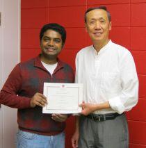 Vinodh Chellamuthu with Keng Deng receiving his certificate
